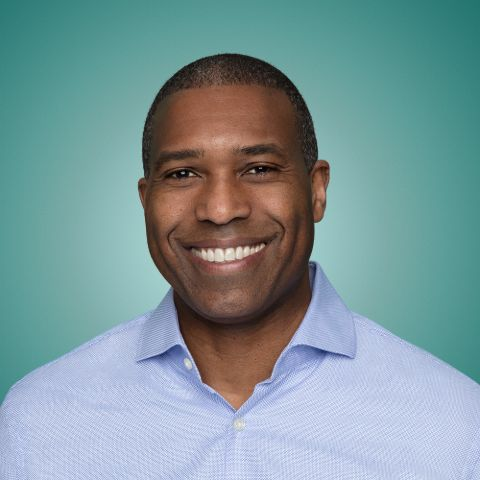 Tony West in a blue shirt poses for a picture.