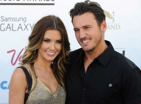 Audrina Patridge in a grey dress poses a picture with ex-husband Corey Bohan.