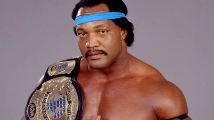 Ron Simmons poses a picture with his belt.
