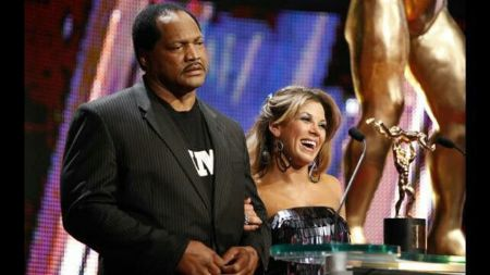 Ron Simmons poses a picture with Micki James in a award-show.