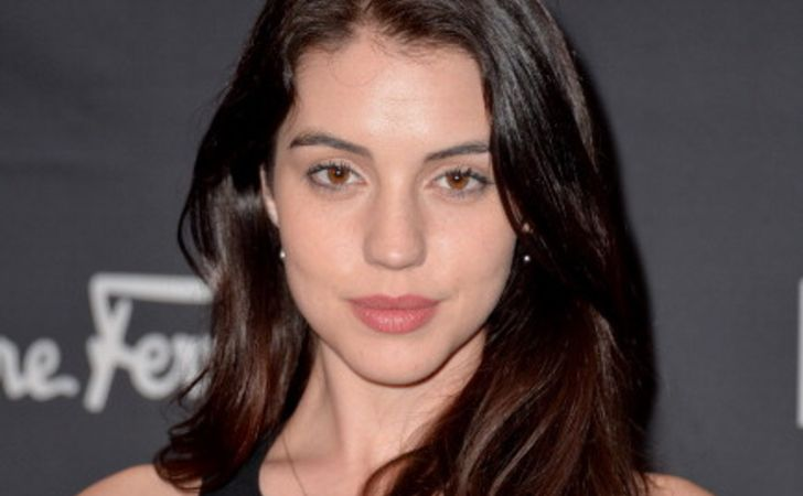 Adelaide Kane in a black top poses for a picture.