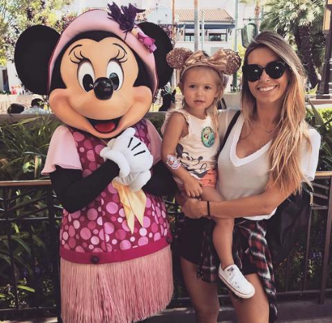 Kirra Max Bohan and her mother pose at Disneyland.