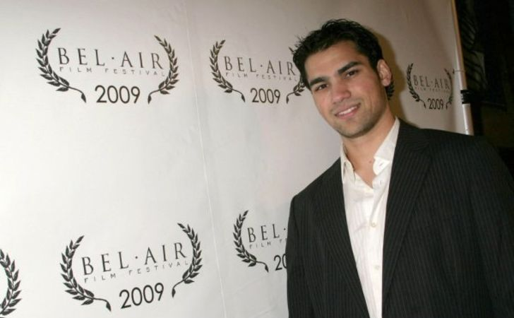 Keyan Safyari in a black coat poses for a picture.