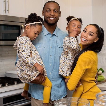 Autumn with her husband, Seyi Ajirotutu, and their twins' daughter