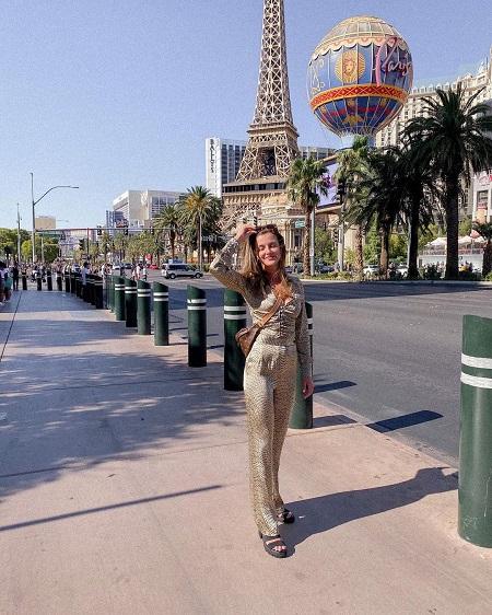 Bridgette Doremus taking a picture in the streets