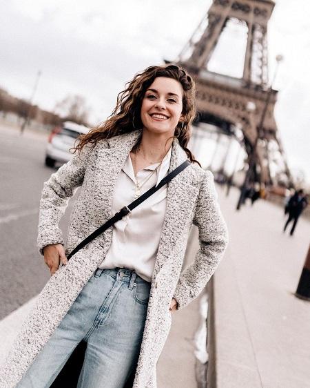 Bridgette Doremus posing in front of the Eiffel Tower