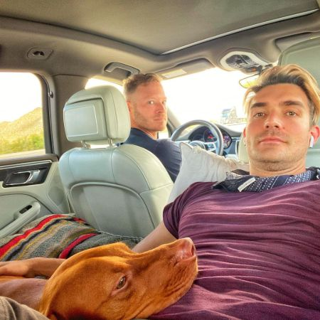 Jacob Jules Villere with his Husband with their dog in their car