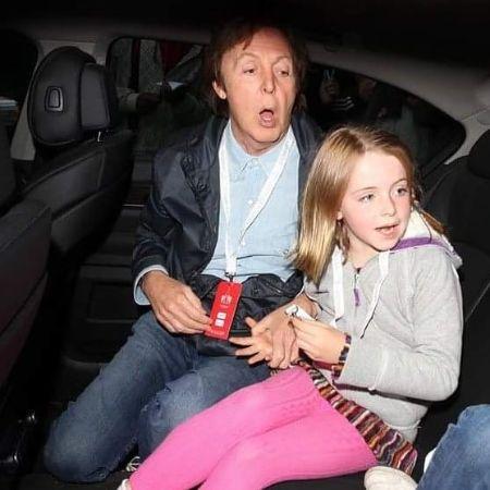 Paul McCartney and Beatrice McCartney in their car