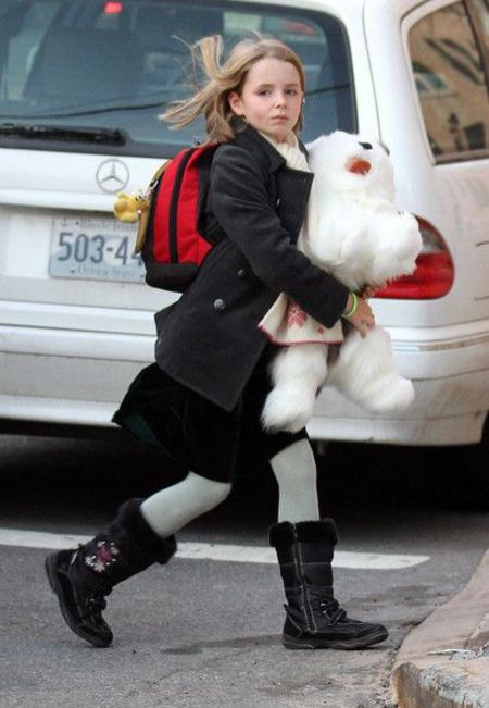 Beatrice McCartney holding a stuffed animal