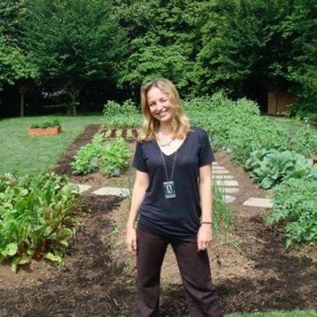 Colombe Jacobsen-Derstine in front of her vegetable garden
