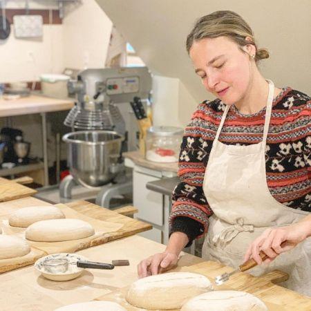 Colombe Jacobsen-Derstine working in the kitchen