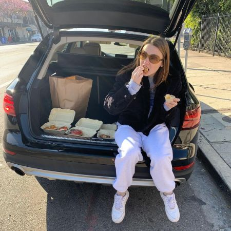 Jessica Barden enjoying Bagels in her car
