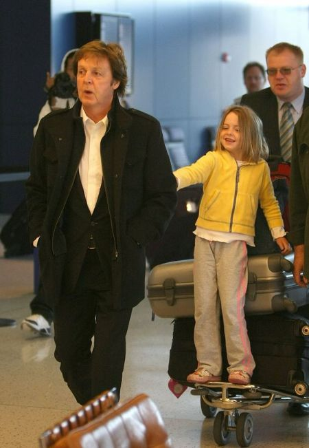 Beatrice McCartney with her father Paul McCartney at an airport