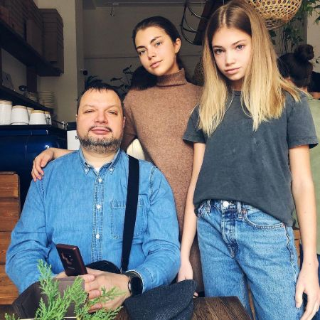 Zhenya Kotova with her sister and father