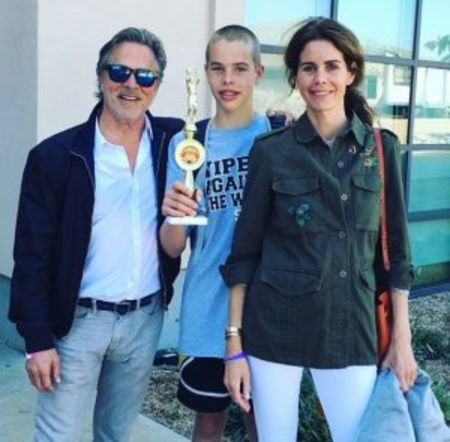 Jasper Breckenridge Johnson with his parents.