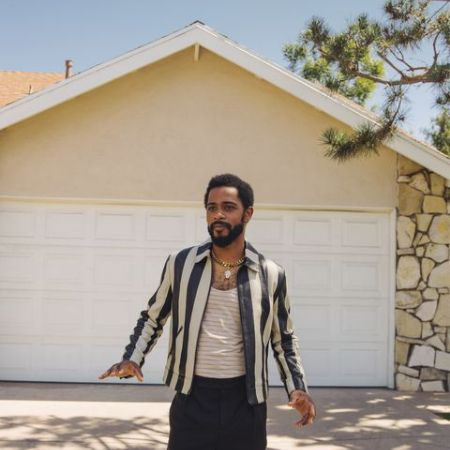 LaKeith standing in front of his house