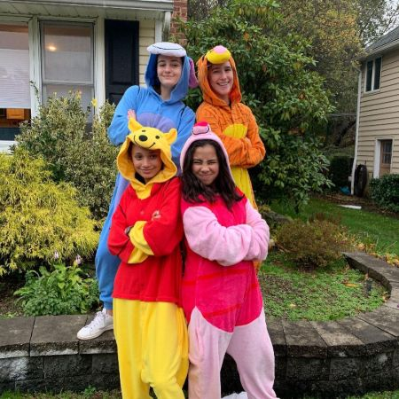 Tess Romero with her friends wearing fury suits