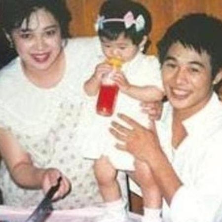Qiuyan Huang with Jet Li and her daughter