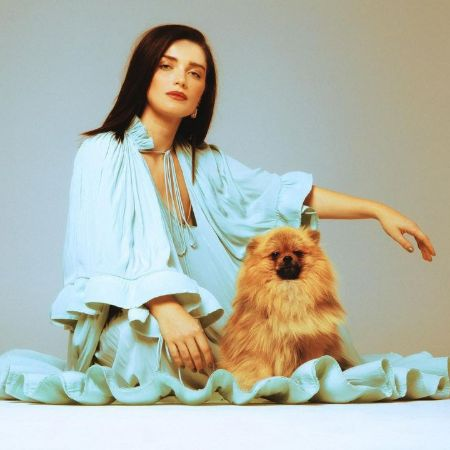 Eve Hewson with BurlyBear in a photoshoot.