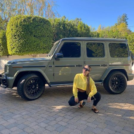 Joanna Zanella in front of her luxurious car.