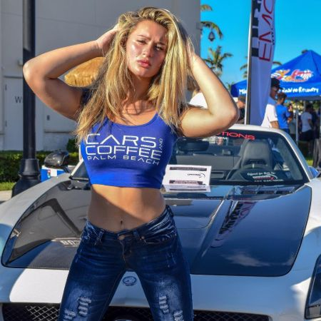 Trinity Morisette in front of her supercar