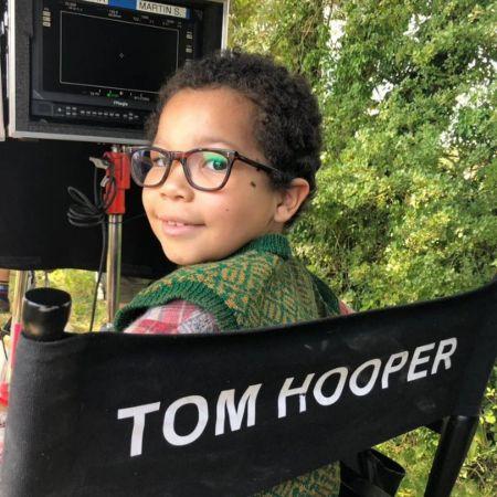 Tyler Howitt chilling in Tom Hopper's, the director's chair on set.