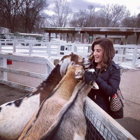 Tracey Anthony having fun visiting goats.