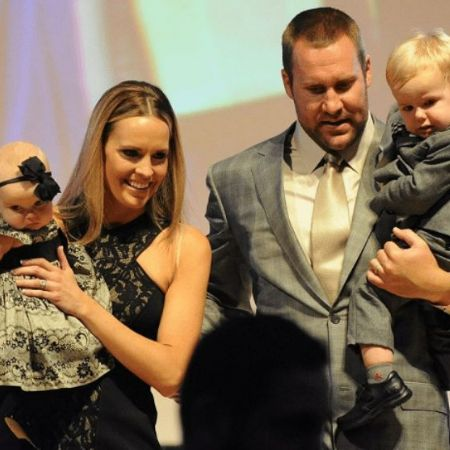 Ashley Harlan with her husband Ben and their children