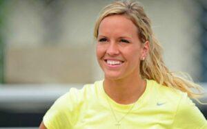 Ashley Harlan wearing a yellow t shirt