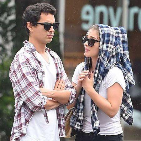 Eve Hewson with her boyfriend, Max Minghella.