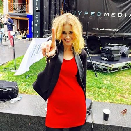 Kate DeAraugo wearing a stunning red dress while attending her musical tour.