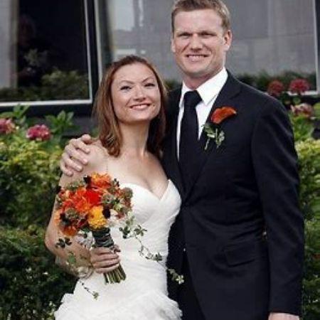 Joely Collins with her husband, Stefan Buitelaar, on their wedding day.