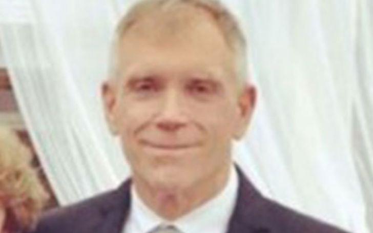 Robert Luke Yunaska wearing suit and posing for a photo.