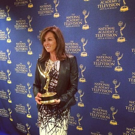 Janet Shamlian posing for a photo with her award.