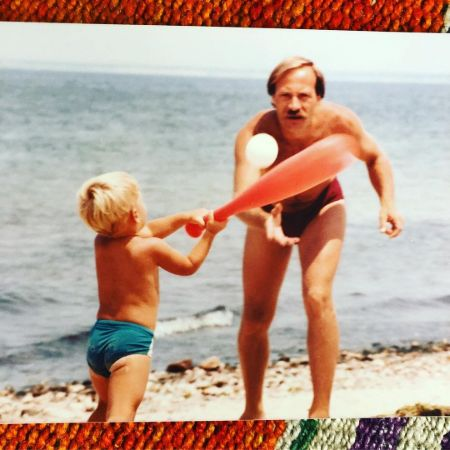 Tony Dokoupil playing baseball on the beach as a child with his father,  Anthony EdwardDokoupil.