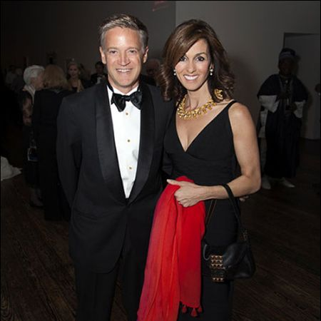 Janet Shamlian attending an event with her husband, LeRoy Melcher III.