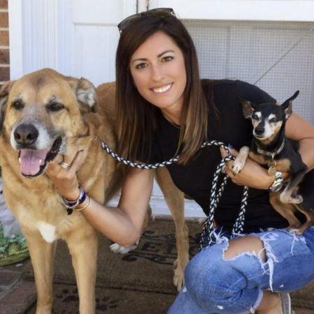 Renee Satterthwaite posing with her dogs.
